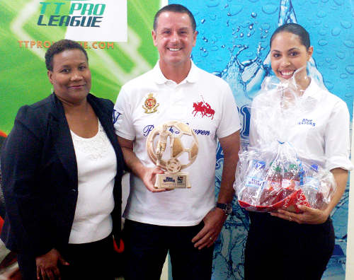 Photo: Central FC coach Terry Fenwick (centre) collects his monthly prize from Blue Waters Communications Officer Cassia Precilla (right) and Pro League secretary Julia Baptiste. (Courtesy TT Pro League)