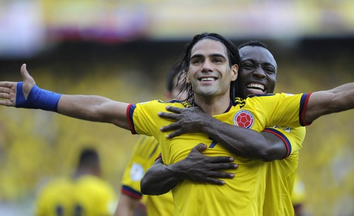 Photo: Colombia and Monaco star Radamel Falcao (centre) is congratulated by defender Pablo Armero during an international fixture. (Copyright AFP 2014/Eitan Abramovich)