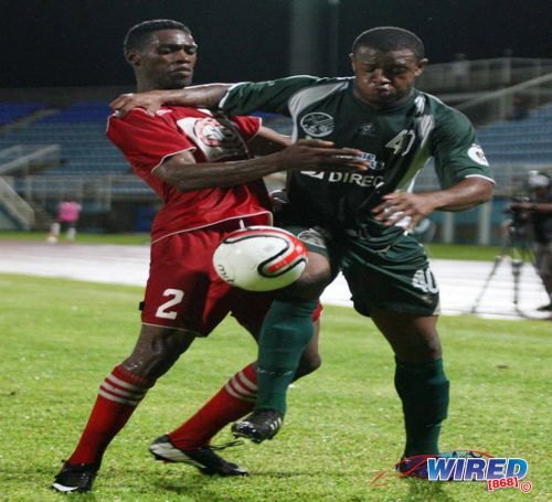 Photo: Central FC defender Elton John (left) tries to wrestle the ball from W Connection midfielder Jomal Williams during the 2013 TTFA FA Trophy final. (Courtesy Wired868)