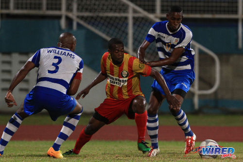 Photo: Point Fortin Civic attacker Marcus Joseph (centre) tries to escape the attentions of Defence Force captain Keston Williams (left) and Ross Russell Jr during a Pro League contest last season. Joseph scored twice and set up another against Police FC before a late foul on him sparked a brawl. (Courtesy Allan V Crane/Wired868)