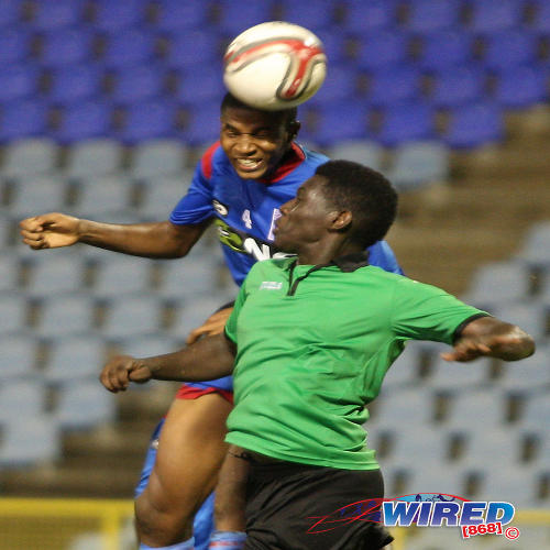 Photo: St Ann's Rangers utility player Jelani Peters (top) rises over a San Juan Jabloteh player to win a header. (Courtesy Wired868)