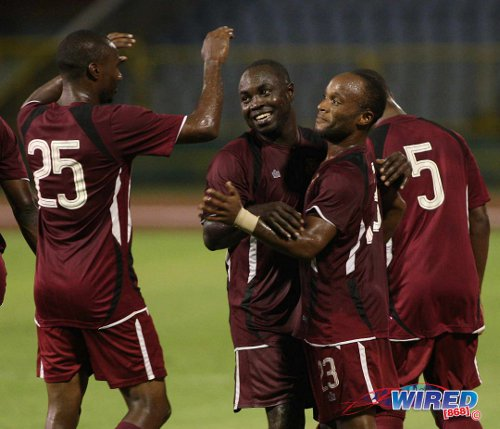 Photo: North East Stars utility player Kenned Hinkson (third from left) is congratulated by teammates Jeromie Williams (second from left) and Keryn Navarro during a previous fixture. (Courtesy Wired868)