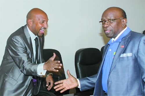 Photo: Sport Minister Anil Roberts (left) greets then National Security Minister Jack Warner. (Courtesy Trinidad Guardian)