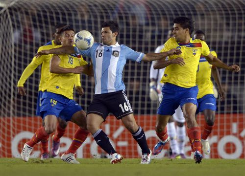 Photo: Argentina forward Sergio Aguero (centre) tries to hold off the entire Ecuador defence during a qualifier at the Monumental stadium in Buenos Aires. Aguero scored eight of his 21 international goals at the Monumental.   (Copyright AFP 2014/Juan Mabromata)
