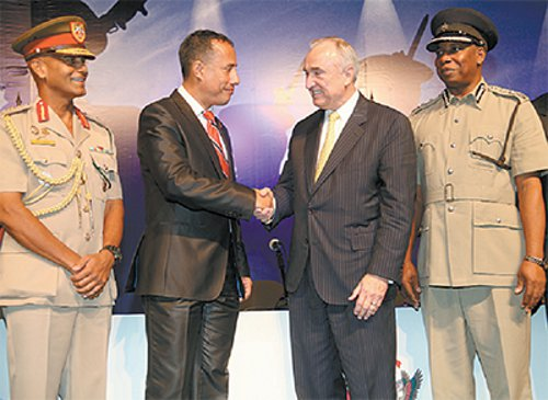 Photo: Can't we make criminals unhappy without making policemen happy? National Security Minister Gary Griffith (second from left) shakes hands with NYPD Commissioner Bill Bratton before chucking him out along with his plans for improved welfare for policemen. (Courtesy Trinidad Guardian)
