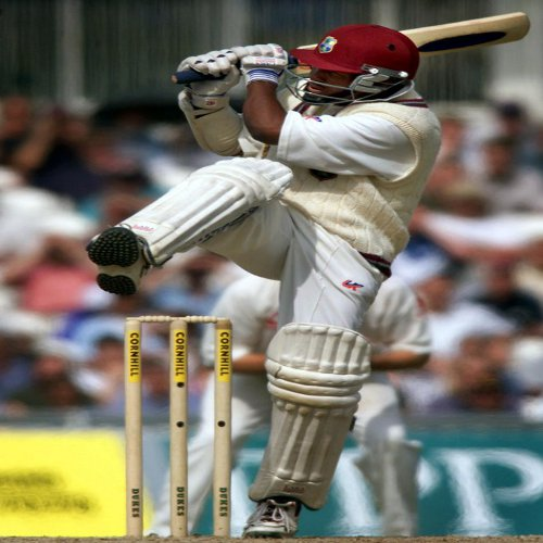 Photo: West Indies and Trinidad and Tobago cricket legend Brian Lara pulls for four against England at the Oval, London on 4 September 2000.  (Copyright AFP 2014/Adrian Dennis)