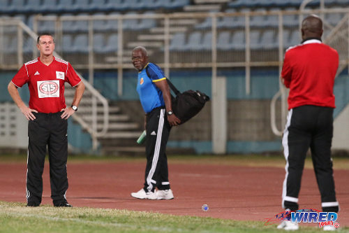 Photo: Central FC coach Terry Fenwick (left) and North East Stars coach Angus Eve glare at each other during their Digicel Pro Bowl quarterfinal clash. Eve was Fenwick's former player and assistant coach at Jabloteh. Central defeated Stars 3-0. (Courtesy Allan V Crane/Wired868)