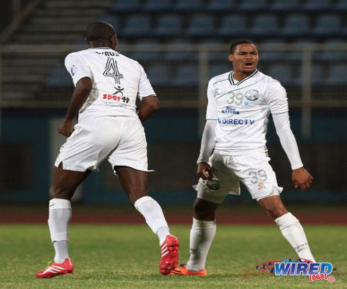 Photo: W Connection right back Alvin Jones (right) celebrates after a goal against Central FC last season. Connection defender Daneil Cyrus (left) is on loan in Vietnam at present. (Courtesy Allan V Crane/Wired868)