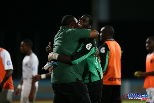 Photo: W Connection chairman David John Williams (left) hugs goalkeeper Julani Archibald after the 2015 Pro Bowl Cup final. (Courtesy Allan V Crane/Wired868)