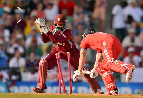 Photo: West Indies wicketkeeper Denesh Ramdin (left) dismisses England batsman Ben Stokes during a T20 match at the Kensington Oval in Bridgetown on March 9, 2014.  (Copyright AFP 2014/Jewel Samad)