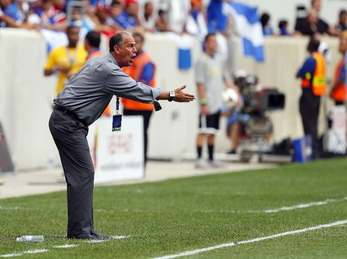 Photo: Trinidad and Tobago head coach Stephen Hart gives instructions during a 2013 CONCACAF Gold Cup fixture against El Salvador. (Copyright AFP 2014/Rich Schultz)
