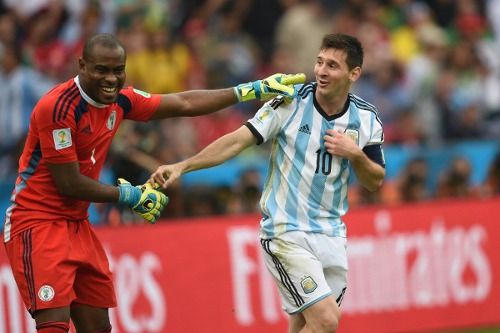 Photo: Argentina captain Lionel Messi (right) and Nigeria goalkeeper Vincent Enyeama share a light moment during their Group F contest. (Copyright AFP 2014/Pedro Ugarte)