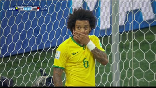 Photo: Brazil defender Marcelo kicked off the 2014 World Cup score summary with an own goal against Croatia. (Courtesy Business Insider)
