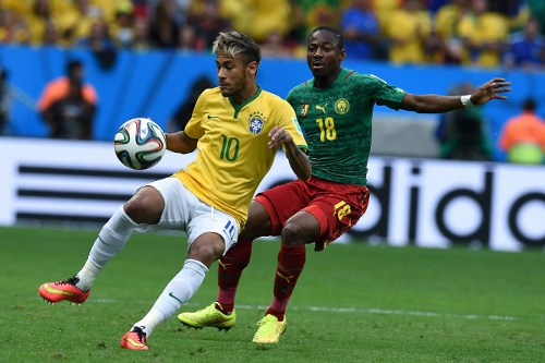 Photo: Brazil forward Neymar (left) prepares to put Cameroon midfielder Enoh Eyong in a youtube video.   (Copyright AFP 2014/Vanderlei Almeida)
