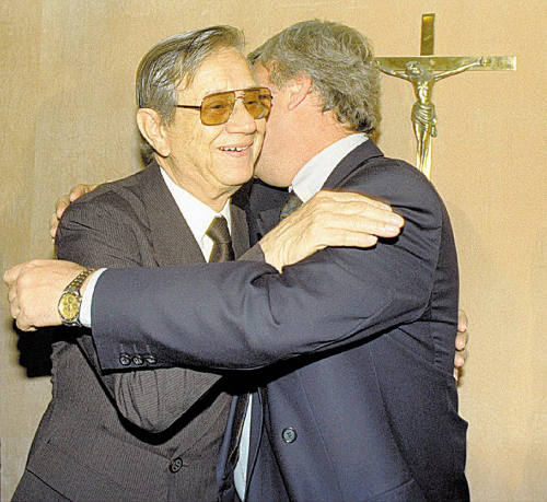 Photo: The late Castor Andrade (left) is greeted by one of his influential associates.