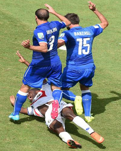 Photo: Costa Rica's forward Joel Campbell (below) narrowly escaped being trampled by Italy defenders Giorgio Chiellini and Andrea Barzagli. (Copyright AFP 2014/Javier Soriano)