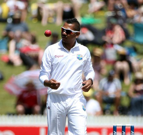 Photo: West Indies spinner Sunil Narine prepares to bowl against New Zealand at Seddon Park, Hamilton on 21 December 2013. (Copyright AFP 2014/Michael Bradley)