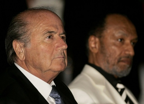 Photo: FIFA president Sepp Blatter (left) and his former contender Mohamed Bin Hammam. (Copyright AFP 2014/Kamarul Akhir)