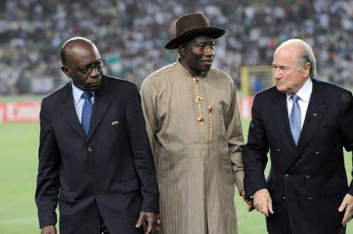 Photo: FIFA president Sepp Blatter (right) and then FIFA vice-president Jack Warner (left) pose with Nigeria President Goodluck Jonathan during the 2009 FIFA U-17 World Cup in Nigeria.  (Copyright AFP 2014/Pius Utomi Ekpei)