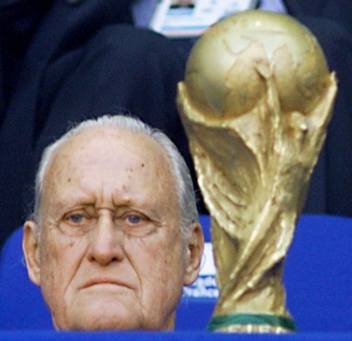 Photo: Former FIFA president Joao Havelange sits next to the World Cup trophy during the 1998 tournament in France. (Copyright AFP 2014/Gabriel Bouys)