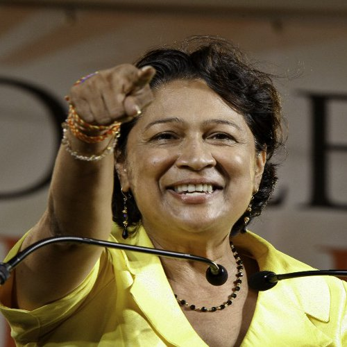 Photo: Trinidad and Tobago Prime Minister Kamla Persad-Bissessar arguably struck a clever blow on her main adversary. (Copyright AFP 2014/Frederic Dubray)