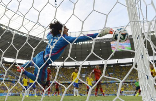 Photo: Mexico goalkeeper Guillermo Ochoa goes full length to keep out a Neymar header. (Copyright AFP 2014/Yuri Cortez)
