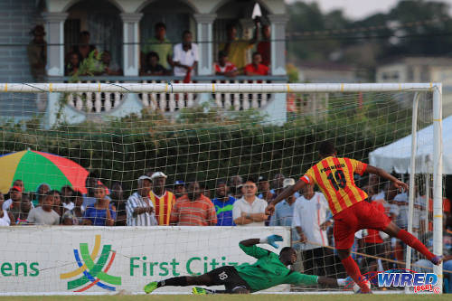 Photo: Point Fortin Civic player Andrei Pacheco drives a penalty past W Connection goalkeeper Julani Archibald during a First Citizens Cup fixture at Mahaica Oval. (Courtesy Allan V. Crane/Wired868)