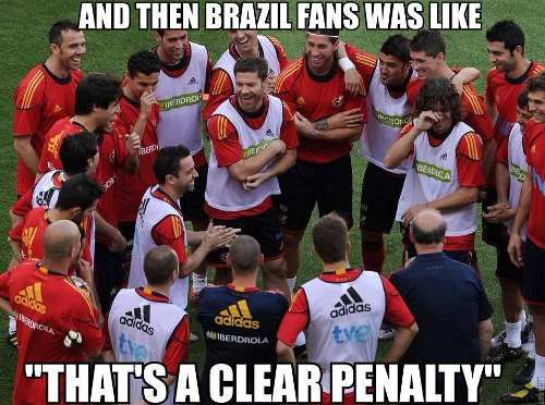 Photo: Spanish players discuss Brazil's opening World Cup performance.