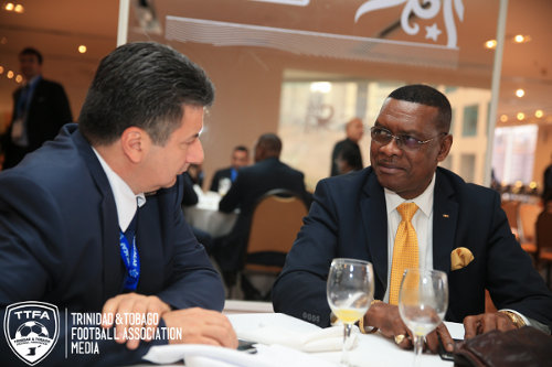 Photo: Former Port of Spain mayor and ex-Trinidad and Tobago Football Association (TTFA) president Raymond Tim Kee (right) enjoys some conversation at the 2014 FIFA Congress in Sao Paulo, Brazil. (Copyright TTFA Media)