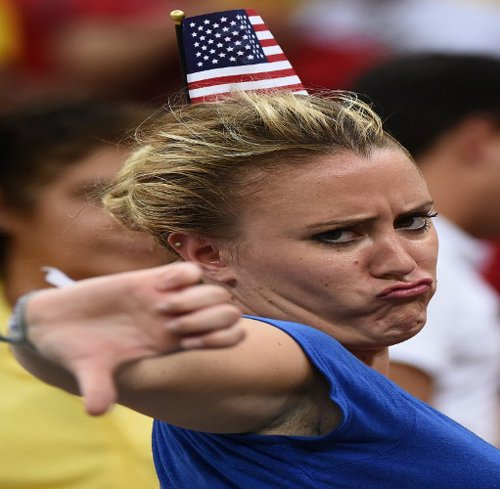 Photo: A United States fan reacts to Portugal's late equaliser in the 2014 World Cup. (Copyright AFP 2014/Raphael Alves)