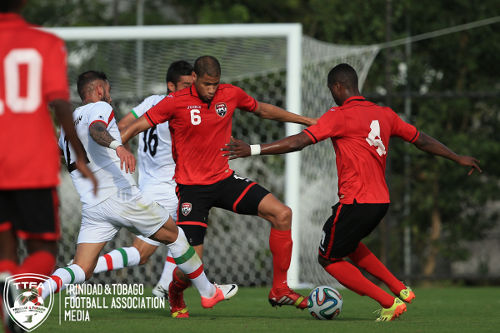 Photo: Trinidad and Tobago national defenders Radanfah Abu Bakr (centre) tries to clear the danger against Iran during a 2014 friendly in Sao Paulo, Brazil. Coach Stephen Hart says he has kept track of Abu Bakr through In Stat Scout. (Courtesy Allan V Crane/Wired868)