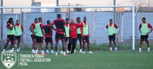 "Photo: Trinidad and Tobago head coach Stephen Hart (centre) makes a point to midfielder Lester Peltier during a training session in Buenos Aires. The ""Soca Warriors"" were without physiotherapist Dave Isaac and goalkeeping coach Michael Maurice who were initially left behind at the Piarco Airport. (Courtesy Allan V Crane/TTFA Media)"