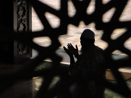 Photo: A Muslim observes prayer time.