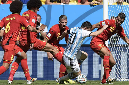 Photo: Argentina forward and captain Lionel Messi (centre) is surrounded by Belgium players (from right) Daniel Van Buyten, Toby Alderweireld, Marouane Fellaini and Axel Witsel during their quarter-final football match at the Mane Garrincha National Stadium in Brasilia.  (Copyright AFP 2014/Juan Mabromata)