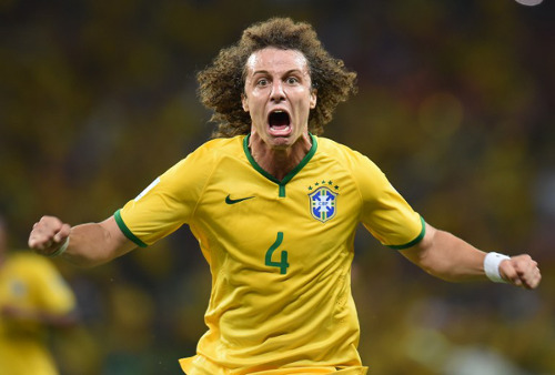 Photo: Sideshow Bob?! Brazil defender David Luiz celebrates the decisive goal against Colombia.  But Luiz was as handy as an ashtray on a motorbike against Germany and Netherlands. (Copyright AFP 2014/Vanderlei Almeida)