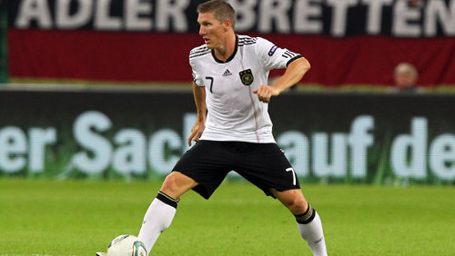 Photo: German midfield ace Bastian Schweinsteiger. (Courtesy Martin Rose/Bongarts)