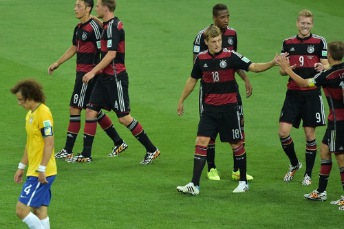 Photo: Germany forward André Schürrle (second from right) celebrates after scoring his team's sixth goal in a 7-1 rout over Brazil.   (Copyright AFP 2014/Gabriel Bouys)
