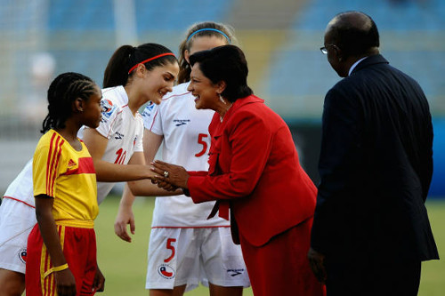 Photo: Prime Minister Kamla Persad-Bissessar (centre) makes an appearance alongside former Cabinet colleague and ex-FIFA vice-president Jack Warner (right) at the launch of the 2010 Under-17 Women's World Cup in Trinidad and Tobago. (Courtesy FIFA)
