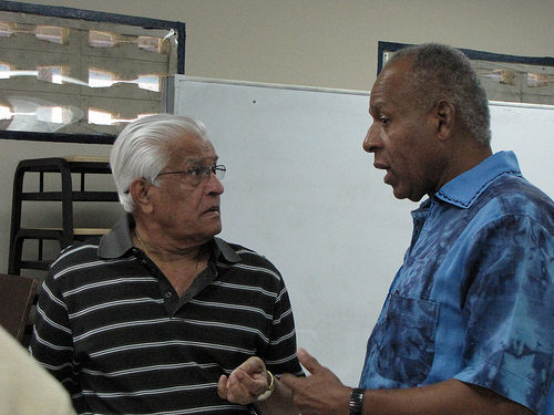 Photo: Former Trinidad and Tobago Prime Ministers Basdeo Panday (left) and Patrick Manning have a chat at a Presentation College reunion. (Copyright Taran Rampersad/Flckr)