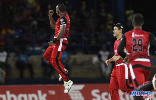 Photo: Trinidad and Tobago Red Steel captain Dwayne Bravo (left) gets fired up during the 2014 competition. (Courtesy Allan V Crane/Wired868)