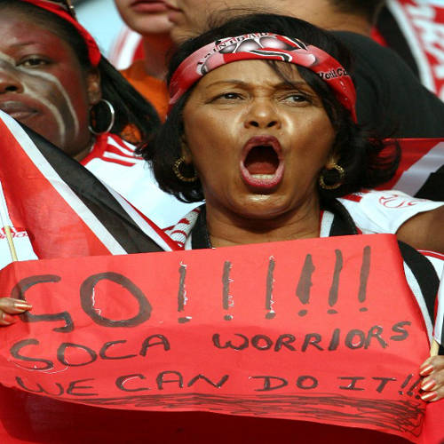 Photo: A Trinidad and Tobago football fan supports the national team at the Germany 2006 World Cup. Richard Braithwaite and Bertille St Clair set the platform for the country's ultimately successful World Cup qualifying campaign. (Copyright AFP 2014/Lluis Gene)