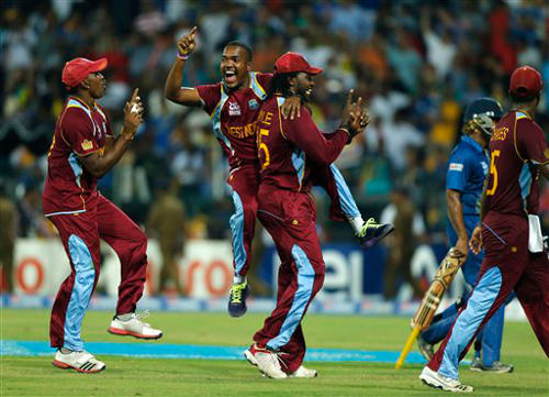 Photo: West Indies players (from left) Dwayne Bravo, Darren Bravo and Chris Gayle enjoy some happy times in the limited overs format. (Courtesy AP)