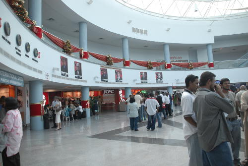 Photo: People mingle at the Piarco International Airport.