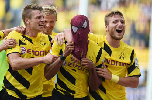 Photo: Borussia Dortmund scorer Pierre-Emerick Aubameyang (second from right) celebrates with teammates Circo Immobile (right) and Lukasz Piszczek (left) during the German Supercup today.  (Copyright Patrik Stollarz/AFP 2014)