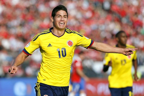 Photo: Colombia star James Rodriguez (left) squeezed Angel Di Maria out of Real Madrid.