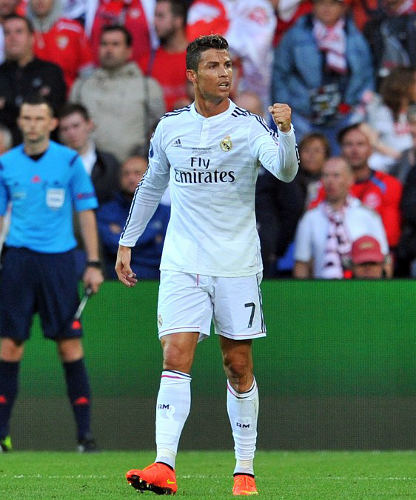 Photo: Real Madrid star Cristiano Ronaldo celebrates his European Super Cup double against Sevilla FC. (Copyright Glyn Kirk/AFP 2014)