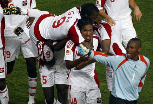 Photo: Former Trinidad and Tobago national under-20 midfielder Jean-Luc Rochford (second from right) is congratulated by teammate Jamal Gay (top) after his goal against Egypt while goalkeeper Glenroy Samuel (right) looks on. Rochford's younger brother, John Paul, is a member of the present national under-17 team.