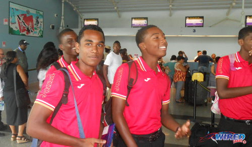 Photo: Trinidad and Tobago defender Matthaeus Granger (left) and his teammates represented their country today in travel uniforms without any national logo or identifying marks. (Copyright Wired868)