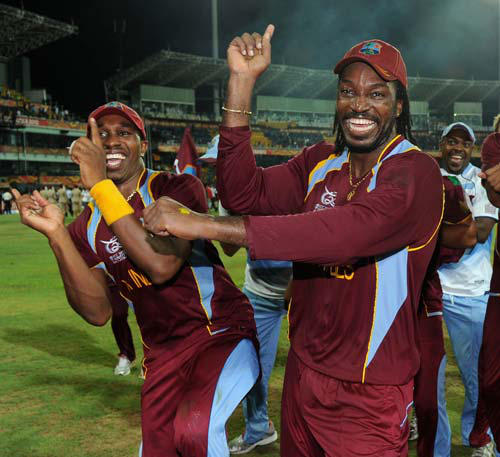 Photo: Neither of West Indies cricket stars Chris Gayle (right) and Dwayne Bravo have been shy about expressing their fondness for Australian television presenter Mel McLaughlin