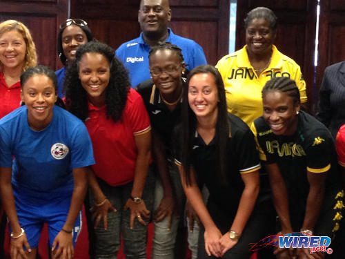 Photo: Trinidad and Tobago players Maylee Attin-Johnson (front row: second from left), Karen Forbes (centre) and Arin King (second from right) pose with their Caribbean rivals at the media launch today. The Trinidad and Tobago players were the only ones without shirt monograms. (Courtesy Wired868)
